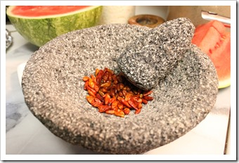 Hot Piquín Pepper Powder | Peppers in Molcajete