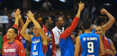 Philippines' players celebrate after winning the 2014 FIBA World basketball championships group B match Senegal vs Philippines at the Palacio Municipal de Deportes in Sevilla on September 4, 2014. Philippines won the match 81-79.  AFP PHOTO / CRISTINA QUICLER