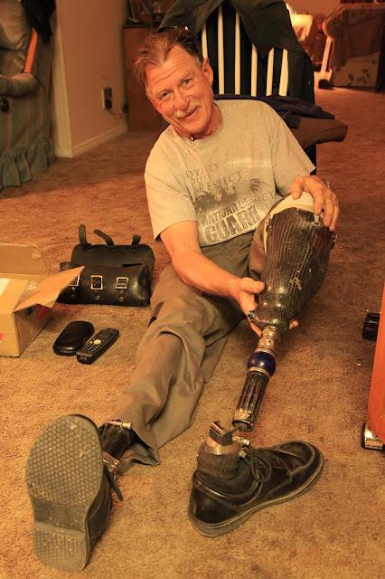 Dave Barr repaing his titaniom foot.jpg