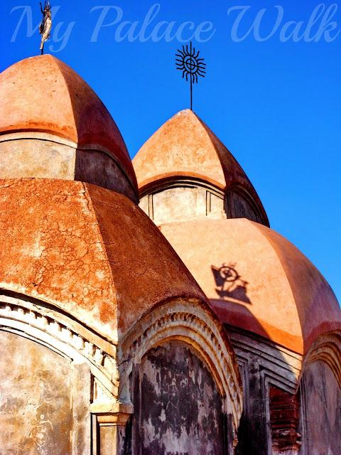 Two ath-challa-style domes with sun emblems on top at Rajbari Temples, Kalna, West Bengal