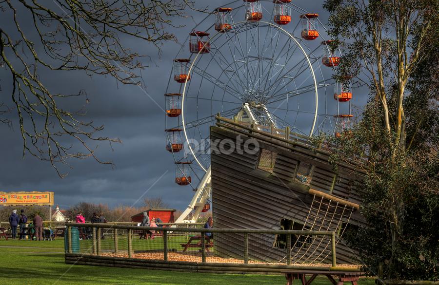 Pirate Ship And Wheel by Simon Eastop - City,  Street & Park  Amusement Parks ( ship, pembrokeshrie, pirate, ferris wheel )