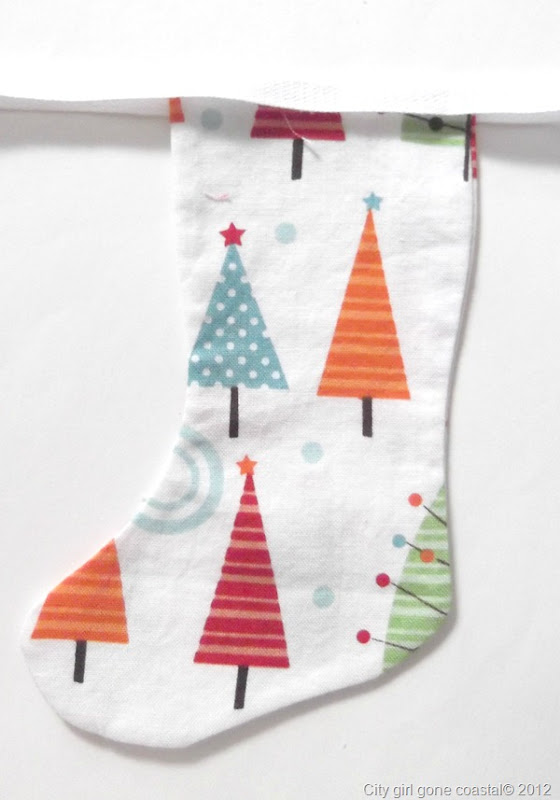 fabric stocking sandwiched between bunting tape