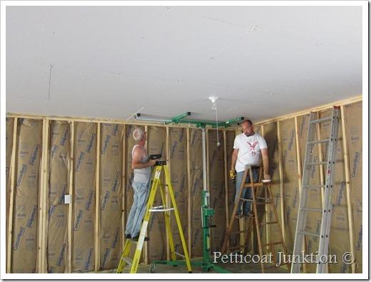 Last piece of sheetrock goes up Petticoat Junktion workshop construction