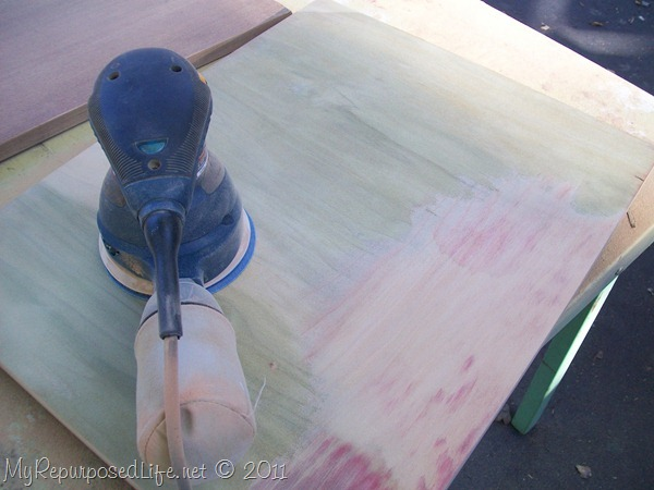 sanding away veneer on sewing cabinet