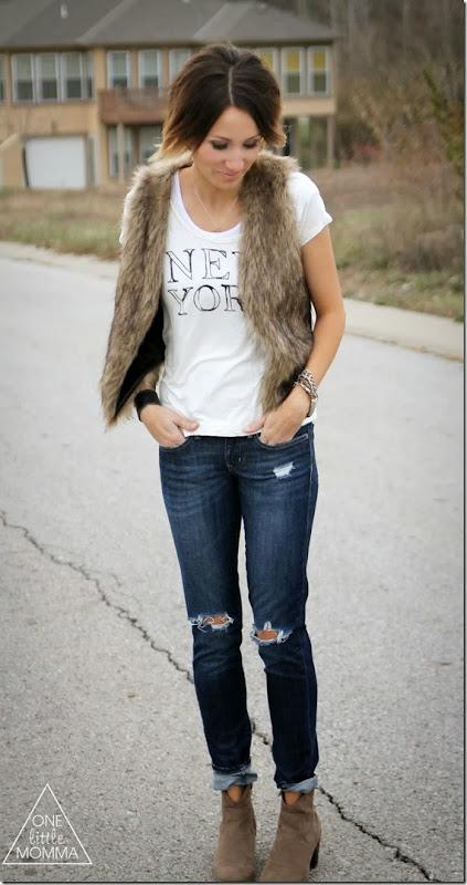 Fur vest, graphic tee and dark denim