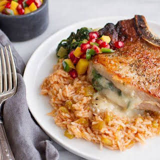 Spicy Cheese-Stuffed Pork Chops with Rice.