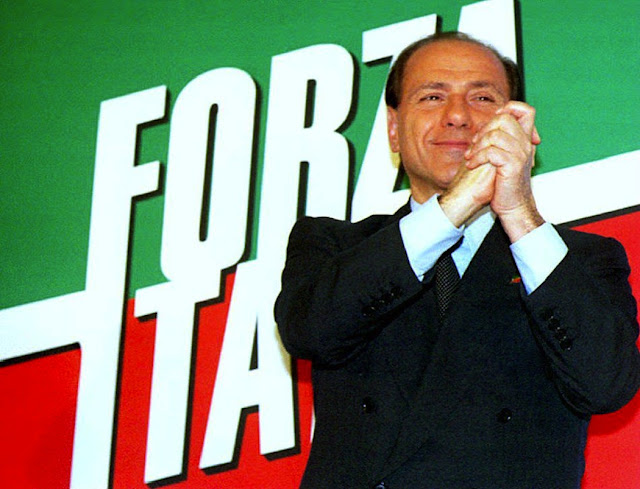 The leader of the Forza Italia party Silvio Berlusconi celebrates 29 March 1994 results from polls giving him and his coalition partners, the Northern League and the National Alliance, a majority of seats in Italy's parliament.