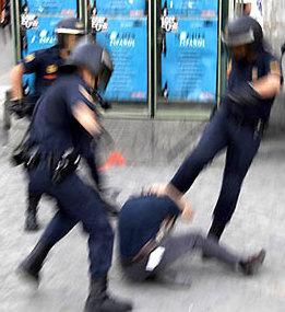 three cops kicking a boy
