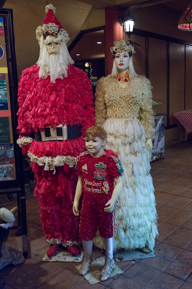 Santa Claus with women and boy, all made with condoms.