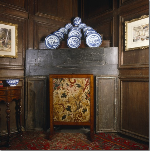 The firescreen of embossed 'gilt' leather in The Oak Bedroom at Nunnington Hall, North Yorkshire