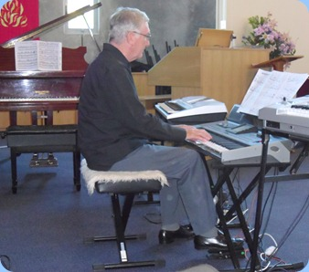 Gordon Sutherland playing his Korg Pa3X keyboard