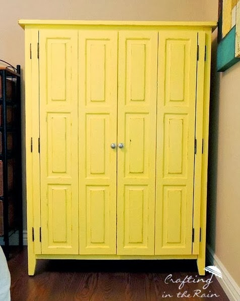painted-yellow-entertainment-center