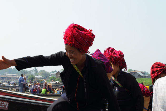 Inle Tribal Woman smiles as she gets off the boat