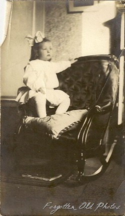 child in chair Pr antiques