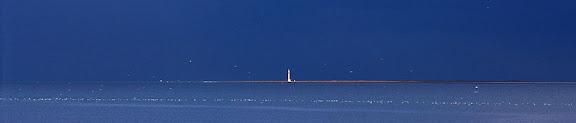 Badia de Sant Jordi i far de la punta del Fangar des de la costa de l'AmpollaDelta de l'Ebre, Parc NaturalDeltebre, Baix Ebre, Tarragona1997