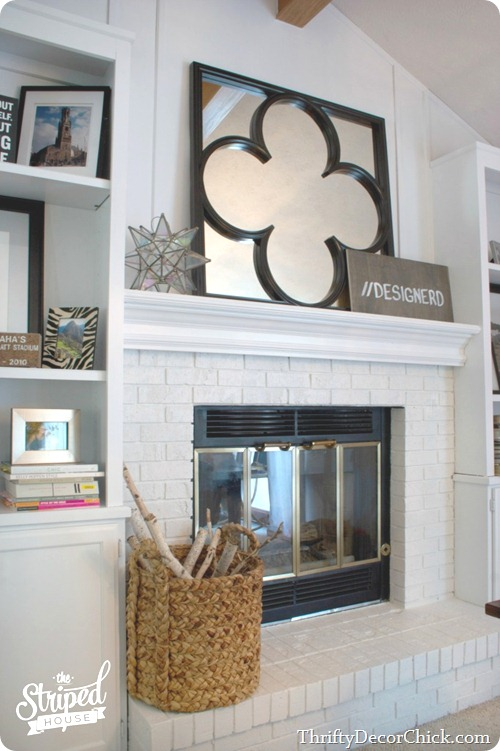 painted brick fireplace and built ins