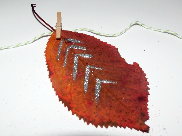 leaf pegged to twine for a leaf garland
