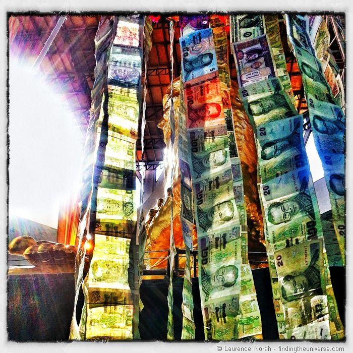Strings of money in Thai temple