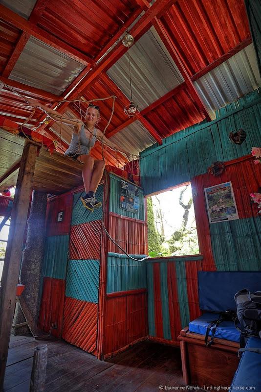 Vera in treehouse interior San Cristobal Island Galagagos Ecuador