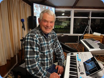 Denis Stewart preparing to play his Yamaha Tyros 4. Photo courtesy of Dennis Lyons