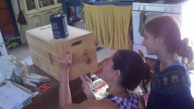 Erin and Serenity decorating the box