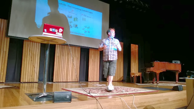 Chris presenting on stage