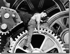 """Charles Chaplin - cena do filme """"Tempos Modernos"""""""