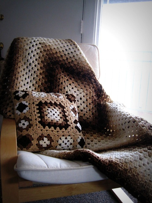 afghan and pillow in neutral colors