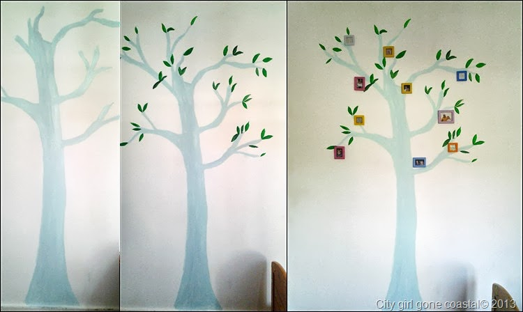 tree painted on wall with photo frames