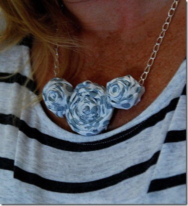 rolled flower necklace on