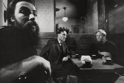 William S. Burroughs with unidentified companions in a Paris cafe, 1959