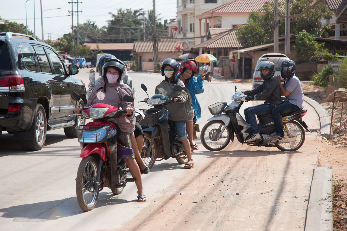 Six DDD students on three motorbikes on main road