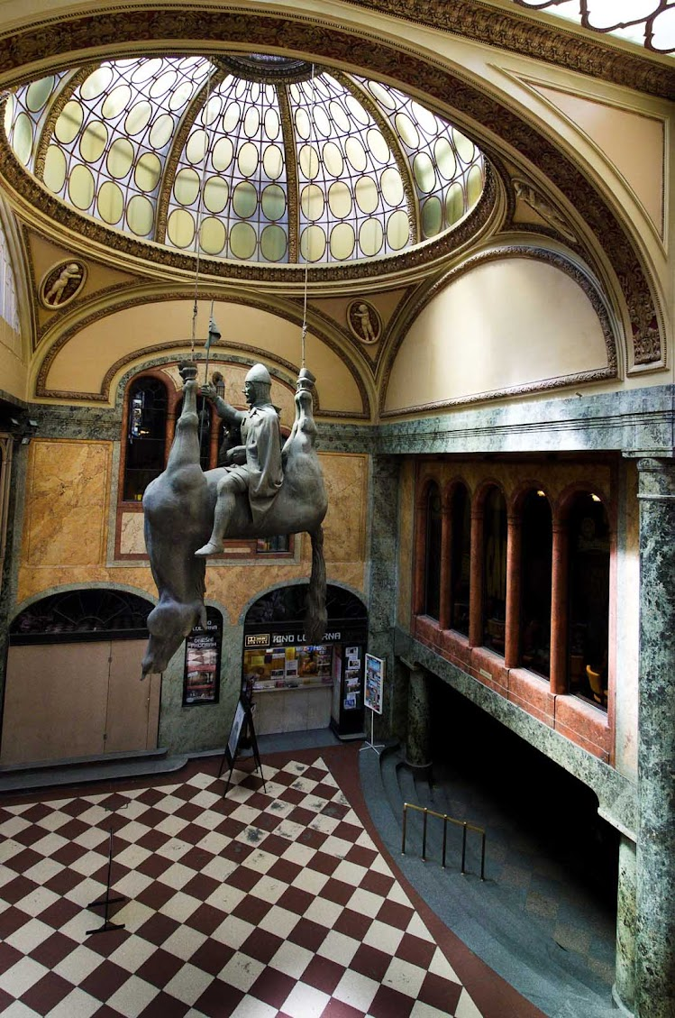 """""""Horse,"""" a statue of Good King Wenceslas at Prague's Lucerna Palace shopping area, was created by David Černý, a Czech sculptor known for his provocative work."""