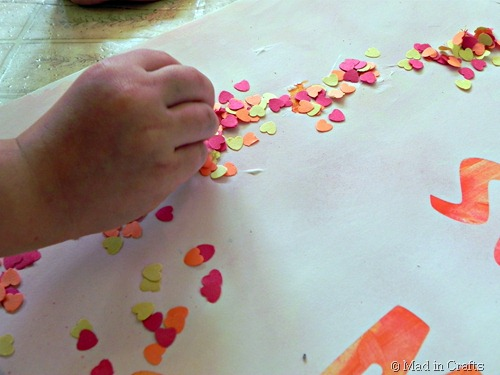 add punched paper confetti