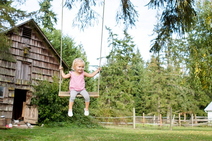 Ellie swinging at the farm