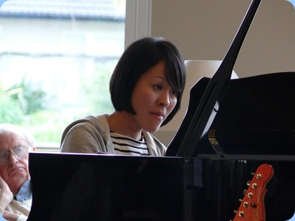 Kuniko Nakatani playing the Kohler and Campbell grand piano. Photo courtesy of Dennis Lyons.