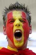 man with Spain flag on face