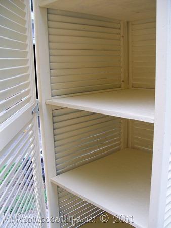 tall yellow shutter cabinet