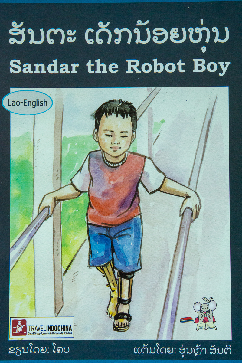 Cover of book: Sandar the Robot Boy, picture of boy with artifical leg