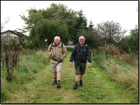Reg and John plod on towards Little Woolden Moss