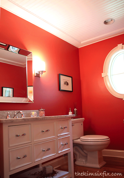 Red bathroom with beadboard ceiling