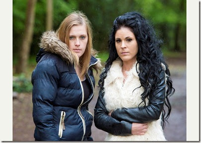 L-R, Kate Channon, 24, and Lola Swan, 28, at Leigh woods, Bristol. See swns story SWBLAIR - It has all the making of a horror film for two women who ran home from a night camping – after photographing a ghost. The two women, who had set up their tent earlier that day in a woodland, felt they were being watched, heard noises in the night and had their stuff mysteriously disappear. Snapping pictures of the fright, it wasn't till the morning that Lola Swan, 28, checked through her photos to see what appears to be a white ghoul, or ghost, peering at them from behind a tree.Lola had been hoping to camp the night in Leigh Woods, Bristol, with her friend, Kate Channon, 24, but things began to get spooky. Throughout the evening, Lola believes something was watching the pair, and when Kate whistled out, someone or something, whistled back. Even though the pair, both from Bristol, were alone for miles around, they heard branches and twigs snapping, and their hammer went missing. When they heard the sound of a little girl's voice , they panicked, packed up their tent and left around 1am.. 14 May 2014