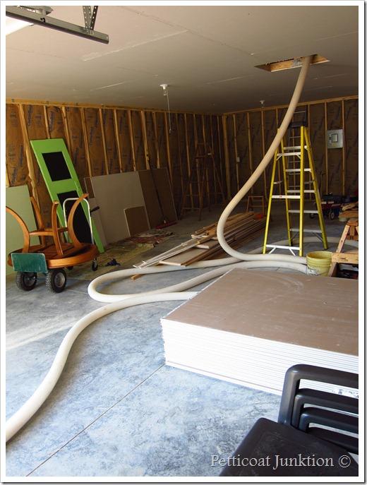 blown attic insulation workshop construction continues
