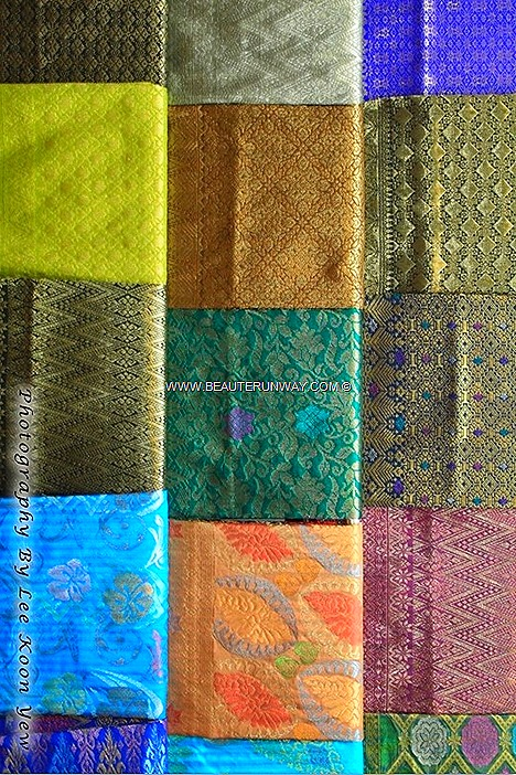 Songket weaving hand-woven intricately patterned silk or cotton brocade fabric with gold silver threads Beautiful patterns simple to sophisticated designs Kelantan luxurious fabrics weaved meticulously  live demonstrations weavers