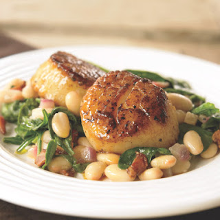 Seared Scallops with White Beans and Spinach.