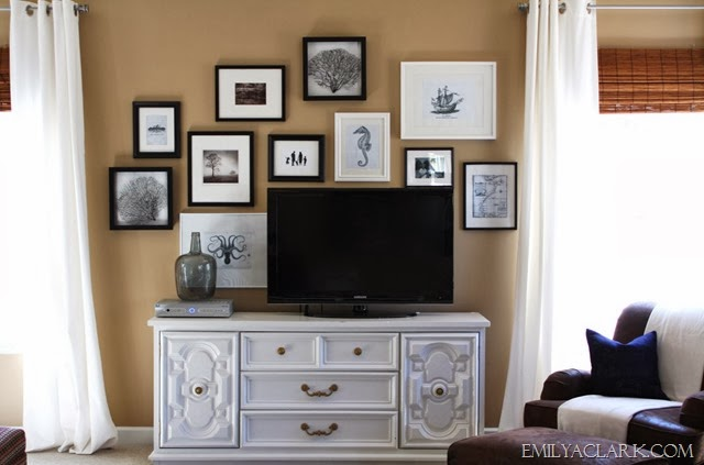 TV on dresser with gallery wall