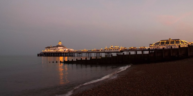 Eastbourne pier at dusk, all lit up
