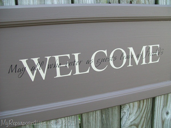 closeup cupboard door sign | Welcome