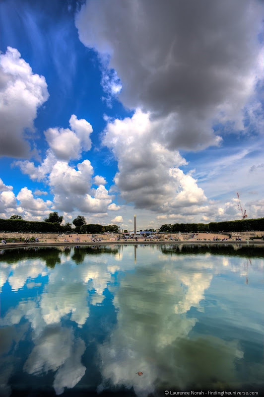 Paris place concorde reflected in tuileries pond