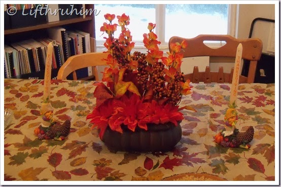 Dining room table all decorated for Thanksgiving.